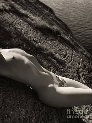 Autumn Photograph - Nude Woman Lying On Rocks By The Water by Oleksiy Maksymenko