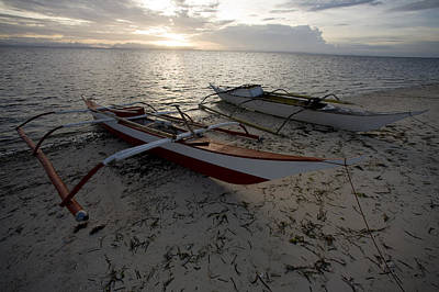 Malapascua Island Photograph - Outrigger Fishing Boats Pulled by Tim Laman