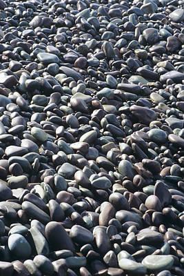 Pebbles On A Beach Art Print by David Aubrey