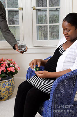 African American Diet Photograph - Pregnant Woman Taking Vitamins by Photo Researchers
