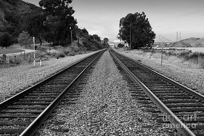 Photograph - Railroad Tracks With The New Alfred Zampa Memorial Bridge And The Old Carquinez Bridge In Distance by Wingsdomain Art and Photography