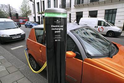 Recharging An Electric Car Art Print by Martin Bond