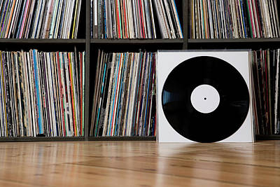 Wall Art - Photograph - Records Leaning Against Shelves by Halfdark