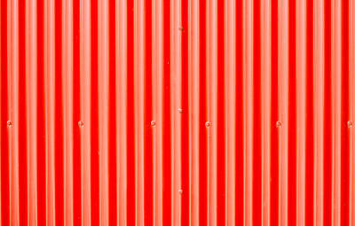 Red Corrugated Metal Print by Tom Gowanlock