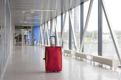 Rolling Luggage Photograph - Rolling Luggage In An Airport Concourse by Jaak Nilson