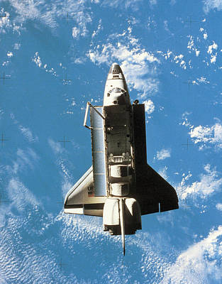 Space Shuttle Orbiting Above Earth Art Print by Stockbyte