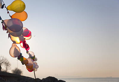 Y120831 Photograph - String Of Balloons Floating In Wind by Henglein and Steets