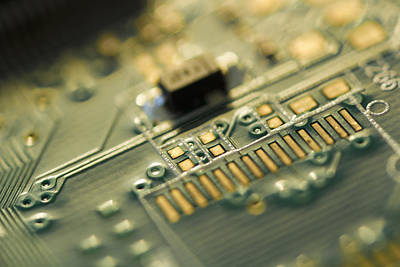 Mother Board Photograph - Studio Shot Of Computer Chip by Tetra Images