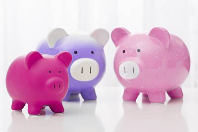 Studio Shot Of Piggy Banks Art Print by Vstock LLC