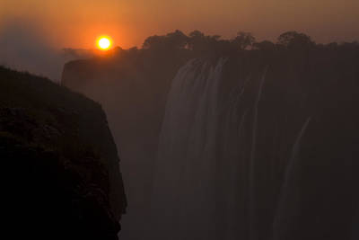 Sunset Over Cascading Victoria Falls Art Print by Ralph Lee Hopkins