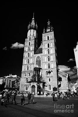 Cracovia Photograph - The 14th Century Gothic Basilica Of The Virgin Mary With Tourists In Rynek Glowny Town Square Krakow by Joe Fox