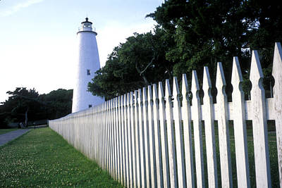 The Lighthouse Stands Behind A Fence Art Print