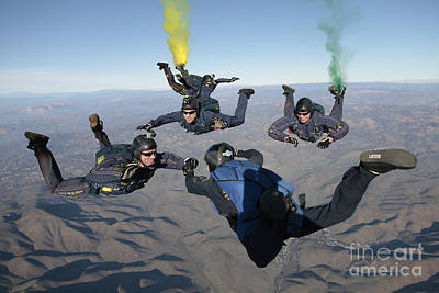 Leap Frog Photograph - The U.s. Navy Parachute Demonstration by Stocktrek Images
