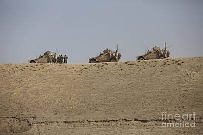 Three M-atvs Guard The Top Of The Wadi Art Print