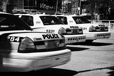 Toronto Police Squad Cars Outside Police Station In Downtown Toronto Ontario Canada Art Print by Joe Fox
