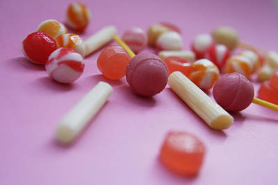 Sweet Success Photograph - Unwrapped Hard Candies On Pink Paper by Asia Images