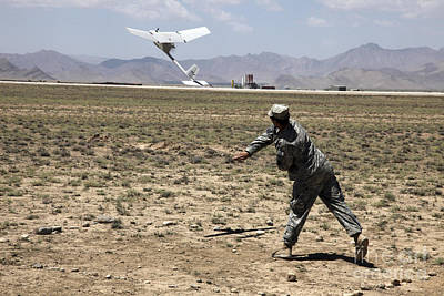 Logar Photograph - U.s. Army Soldier Launches An Rq-11 by Stocktrek Images
