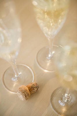 Photograph - Usa, New Jersey, Jersey City, Champagne Flutes And Cork On Table by Jamie Grill