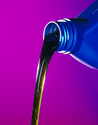 View Of Lubricating Oil Pouring From Its Bottle Art Print by Tek Image