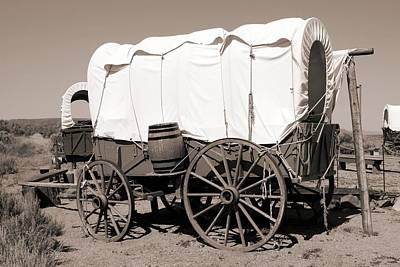 Wooden Farm Wagon Photograph - Wild West Covered Wagons by Tony Craddock
