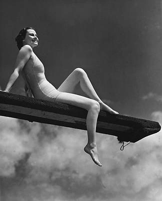 Woman Sitting On Divingboard Art Print by George Marks