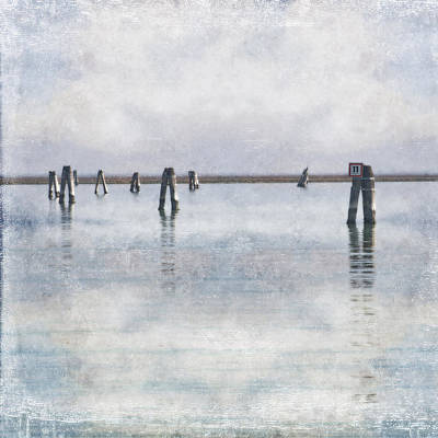 wood piles in the lagoon of Venice Art Print by Joana Kruse