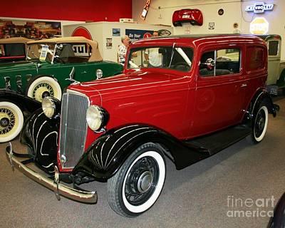 Photograph - 1930's Antique Chevrolet Sedan by John Black
