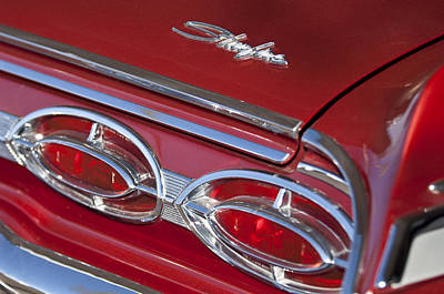 Photograph - 1962 Oldsmobile Starfire Hardtop Taillights And Emblems by Jill Reger