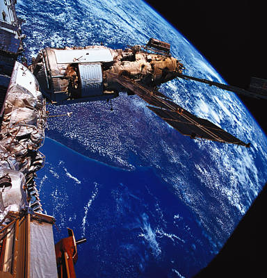 Space Ships Photograph - A Satellite Orbiting Above The Earth by Stockbyte