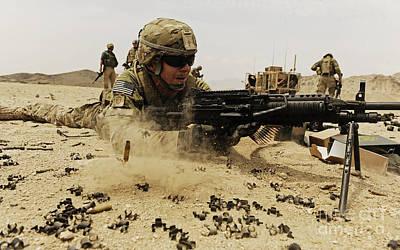 A Soldier Firing His Mk-48 Machine Gun Art Print by Stocktrek Images