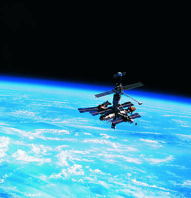 Space Ships Photograph - A Space Station Orbiting Above Earth by Stockbyte