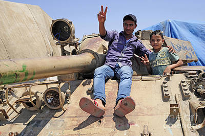 A T-55 Tank With Two Children Playing Print by Andrew Chittock