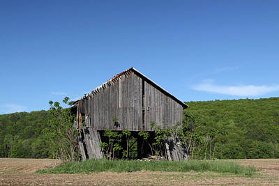 Photograph - Abandoned Old Farm Building With Blue Sky by John Stephens