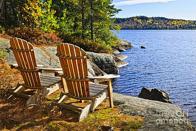 Adirondack Chairs At Lake Shore Art Print by Elena Elisseeva