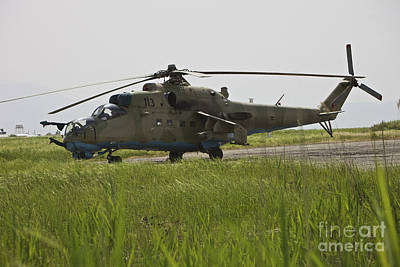 Kitchen Food And Drink Signs - An Mi-35 Attack Helicopter At Kunduz by Terry Moore