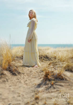 Beautiful Young Woman In Yellow Gown By The Sea Art Print