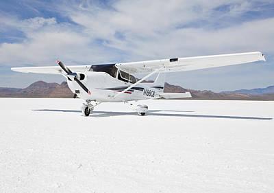 Cessna Aircraft On Bonneville Salt Flats Art Print by Paul Edmondson