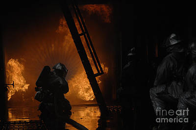 Firefighters Extinguish A Simulated Art Print by Stocktrek Images