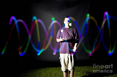 Juggling Light-up Balls Print by Ted Kinsman