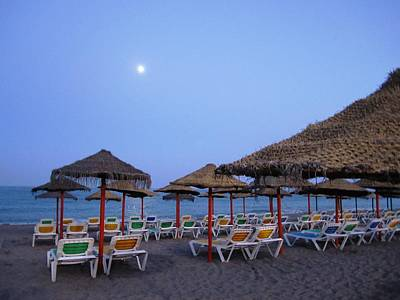 Moon Rise Poster Photograph - Moon Light Beach Umbrellas And Chairs Costa Del Sol Spain by John Shiron