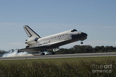 Space Shuttle Atlantis Touches Art Print by Stocktrek Images