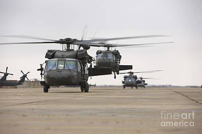 Uh-60 Black Hawks Taxis Art Print by Terry Moore