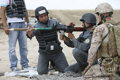 An Afghan Police Student Loads A Rpg-7 Art Print by Terry Moore