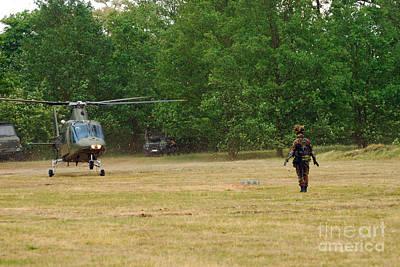 Agustawestland Aw109 Photograph - An Agusta A109 Helicopter by Luc De Jaeger