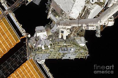 Astronauts Working On The International Art Print by Stocktrek Images