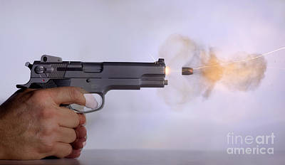 Handgun And .45 Caliber Bullet Print by Ted Kinsman