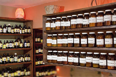 Row Of Bottles Photograph - Shelves Full Of Jars In An Apothecary by Bryan Mullennix