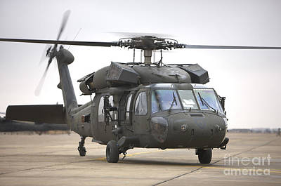 A Uh-60 Black Hawk Taxis Art Print by Terry Moore
