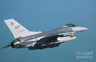 Photograph - An F-16 Fighting Falcon In Flight by Stocktrek Images