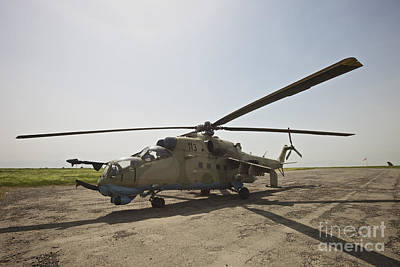 An Mi-35 Attack Helicopter At Kunduz Art Print by Terry Moore